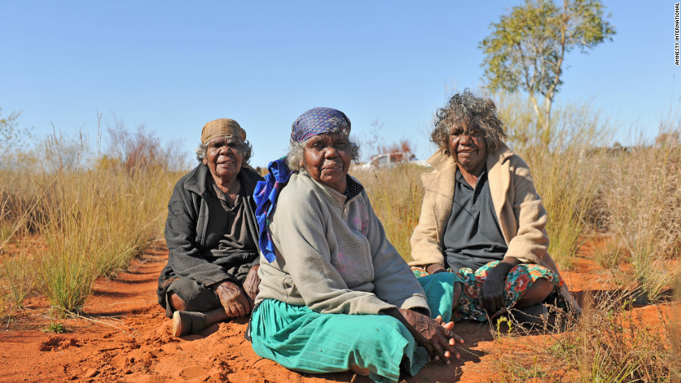 Three sisters on their traditional land at Mosquito Bore, near the track of the dreaming story of the Mountain Devil Lizard, Utopia homelands, Northern Territory, Australia.