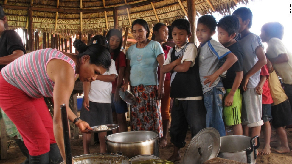 Communal lunch being served in the Sarayaku community, Ecuador, in July 2011.