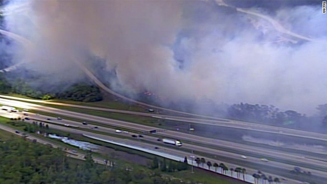 Smoke from a brush fire closed sections of highway in Orange County, Florida.