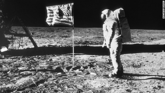 July 1969: American astronaut Edwin 'Buzz' Aldrin on the surface of the moon next to the American flag during the NASA Apollo 11 mission. Prints from Aldrin's spaceboots mark the lunar terrain. Aldrin was the second man to walk on the moon, after Neil Armstrong. (Photo by Hulton Archive/Getty Images)