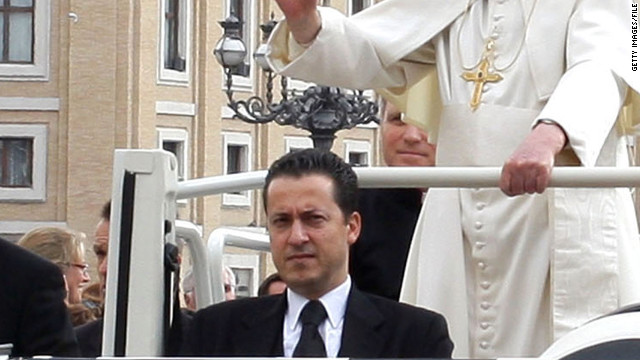 Paolo Gabriele rides in the pope mobile with Pope Benedict XVI in St. Peter's Square in March 2011