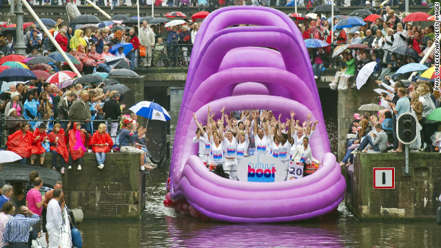 Patricipants of  Amsterdam's annual Canal Pride wave to crowds.