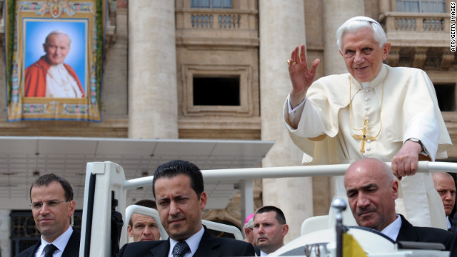 Pope Benedict XVI  travels with his butler Paolo Gabriele, center, who was arrested in connection with leaked papal documents.
