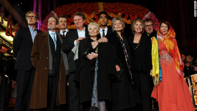"""Hotel Marigold"" actors Bill Nighy, from left, Ronald Pickup, producer Graham Broadbent, director John Madden, actors Judi Dench, Dev Patel, Diana Hardcastle, Penelope Wilton, Tom Wilkinson and Celia Imrie at the premiere of their film in London."