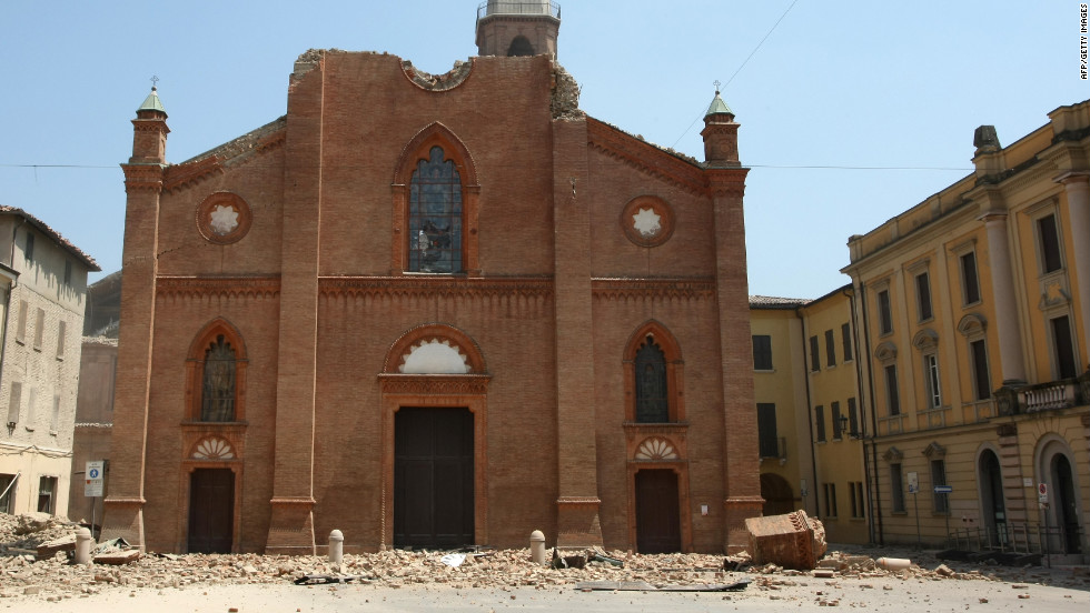 The cathedral of Mirandola is badly damaged, with large parts of it scattered across the ground. Police tape is strung across several areas of the town to prevent more casualties.