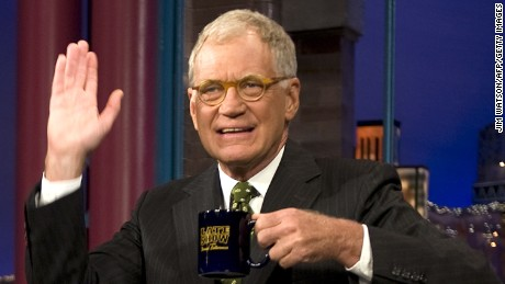 FILES- Picture taken on September 21, 2009, shows US President Barack Obama (L) joking with David Letterman during a taping of the Late Show with David Letterman in New York. Letterman celebrates his 65 birthday on April 12, 2012. AFP PHOTO/JIM WATSON (Photo credit should read JIM WATSON/AFP/Getty Images)