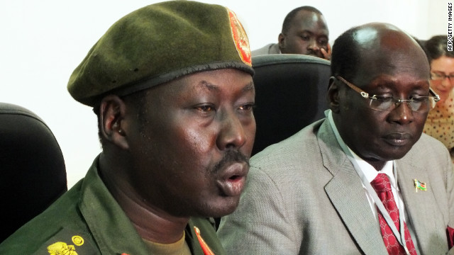 File photo of South Sudan's army spokesman Philip Aguer, left, who is skeptical that troops have pulled out.