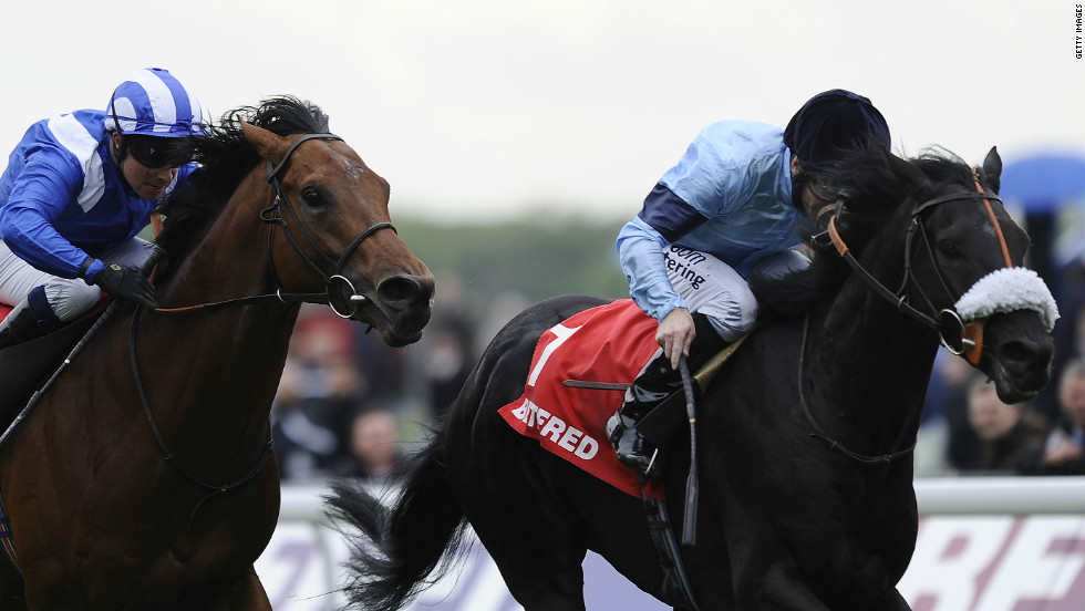 Bonfire (R) on his way to winning the Dante Stakes in May, a triumph that secured his Derby place.