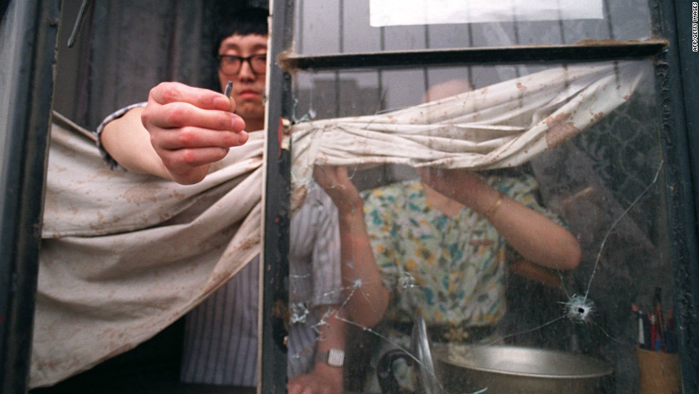 A resident on the west side of Tiananmen Square shows a slug from an automatic rifle fired by the army that went through his flat's window.