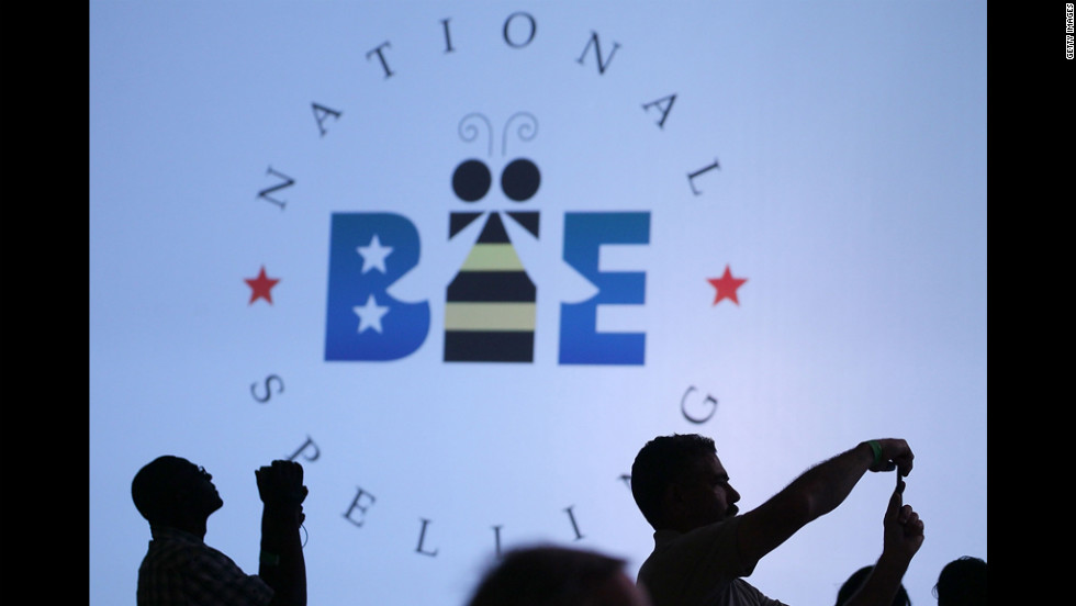 Spectators photograph the contestants during the third round of the 2012 Scripps National Spelling Bee in National Harbor, Maryland, on Wednesday, May 30.