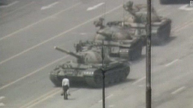 "In this iconic image, an anonymous ""tank man"" stands in protest in front of a column of Chinese tanks on June 5, 1989."