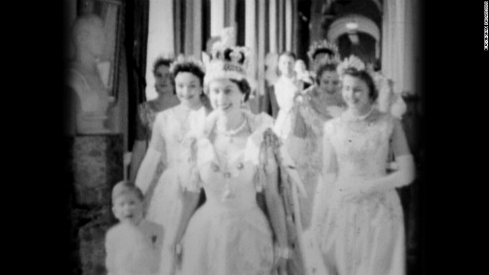 The Queen in the Principal Corridor at Buckingham Palace on Coronation Day, 2nd June 1953, accompanied by Prince Charles.