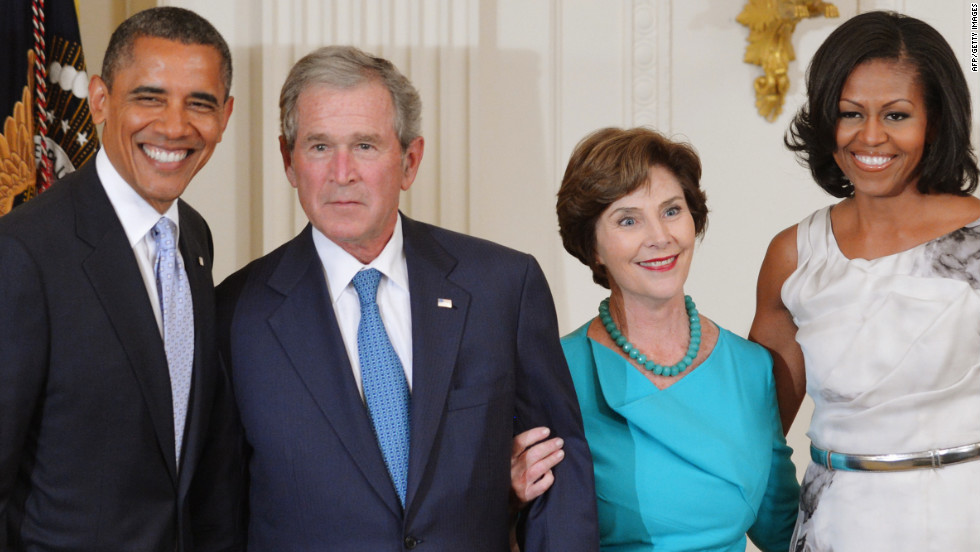 """Bush also joked with Michelle Obama. """"Dolley Madison famously saved this portrait of the first George W.,"""" Bush told the laughing crowd. """"Now Michelle, if anything happens, there's your man,"""" he continued, pointing to his new portrait."""