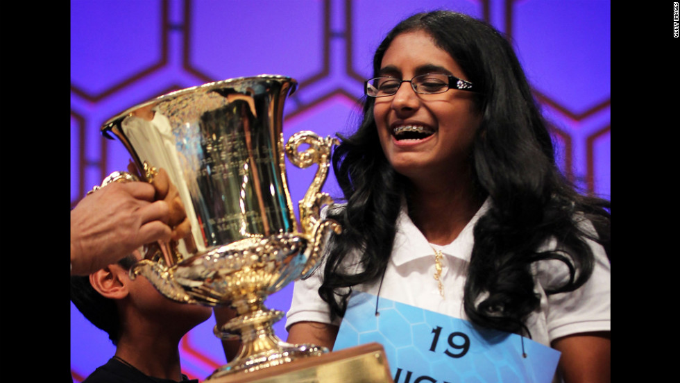 Snigdha Nandipati holds the trophy after winning the 2012 Scripps National Spelling Bee on Thursday.