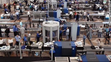 'Holiday travel ramps up amid air scares' from the web at 'http://i2.cdn.turner.com/cnnnext/dam/assets/120601090231-tsa-3-large-169.jpg'