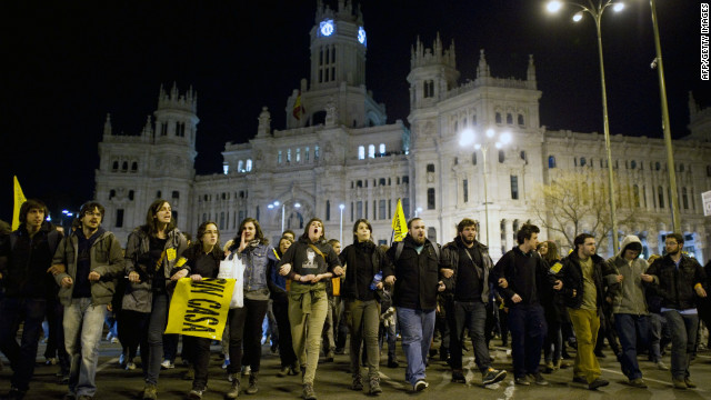 Young Spainish people protest during a national strike in Madrid on March 29, 2012.