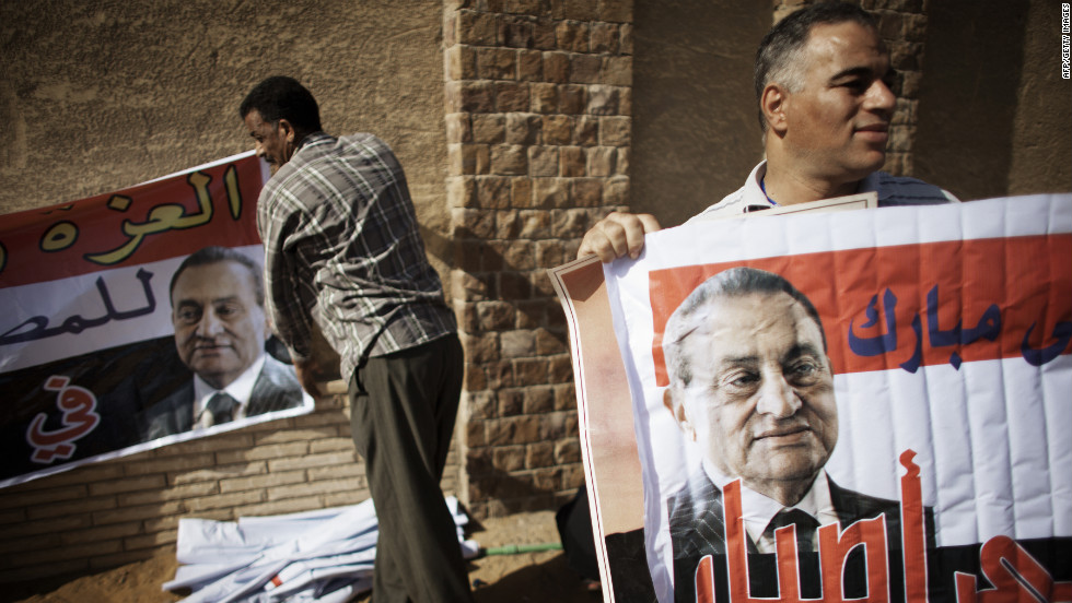 Mubarak supporters rally outside the courthouse after news of the verdict was handed down.