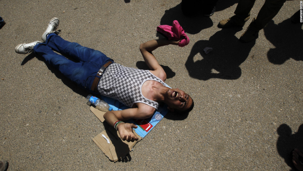 An anti-regime protester, who wanted the death penalty for Egypt's former leader, reacts to news of Mubarak's sentence.