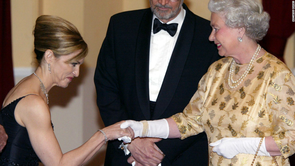The queen of pop meets the queen of England -- Madonna curtsies as she meets the queen at the world premiere for 2002 Bond film, 'Die Another Day.'
