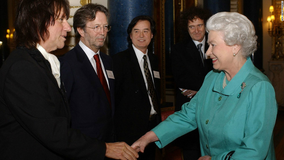 Queen Elizabeth II meets legendary guitarists Jeff Beck, Eric Clapton, Jimmy Page and Brian May during a reception at Buckingham Palace in London, 1 March 2005. The all-star gathering is a royal tribute to Britain's music industry and follows an earlier children's concert at the Palace