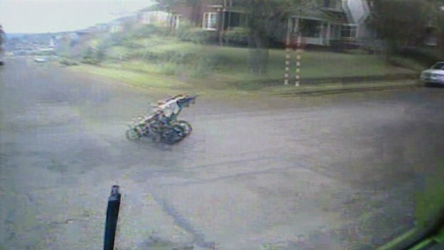 Runaway stroller rolls into busy street