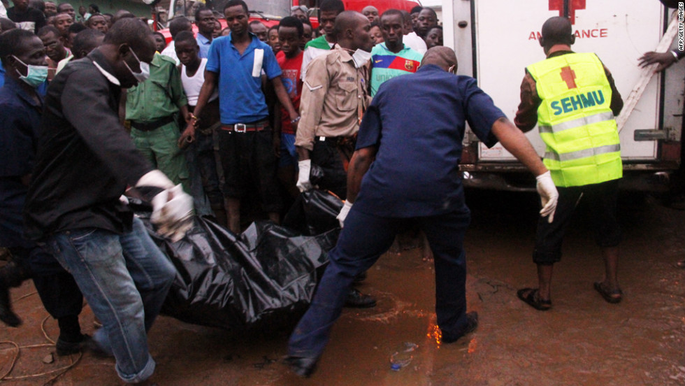 Rescuers carry remains to an ambulance on Sunday.