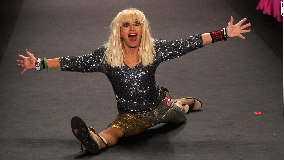 Betsey Johnson does a split on the runway at the Betsey Johnson Fall 2012 fashion show. She is also known for doing a cartwheel at the end of each fashion show.