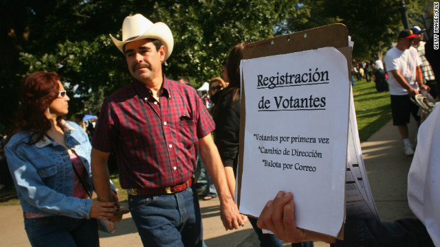 Democratic Party workers try to register new voters at a celebration marking Mexican Independence Day in September 2008.