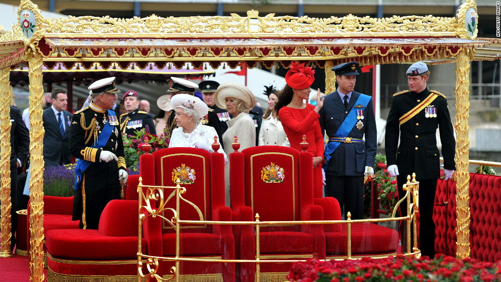 Members of the Royal family (from left to right) Prince Charles, Prince of Wales, Queen Elizabeth II, Camilla, Duchess of Cornwall, Catherine, Duchess of Cambridge, Prince William and Prince Harry stand onboard the Spirit of Chartwell.