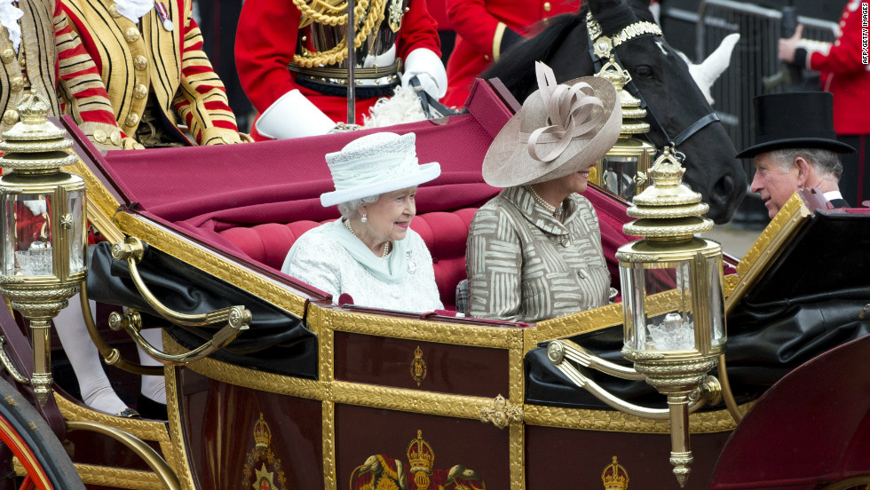 Britain's Queen Elizabeth II, Camilla, Duchess of Cornwall and Prince Charles, Prince of Wales ride in the 1902 State Landau coach during the carriage procession from Westminster Hall to Buckingham Palace.