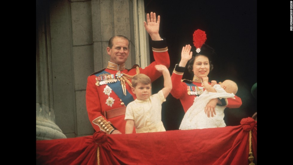 June 13, 1964: Queen Elizabeth II, Prince Philip, Prince Andrew and Prince Edward wave to the crowds from the balcony at Buckingham Palace during the Trooping of the Colour.