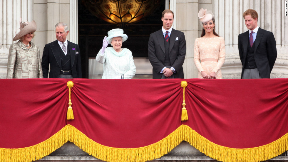 Members of the British royal family wave to the crowds from Buckingham Palace on June 5, 2012, as part of the Queen's Diamond Jubilee celebrations.