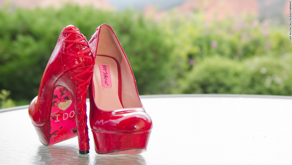 "Betsy Johnson wore these ""I Do"" emblazoned red slippers by Betsey Johnson because she and her husband are from Kansas."