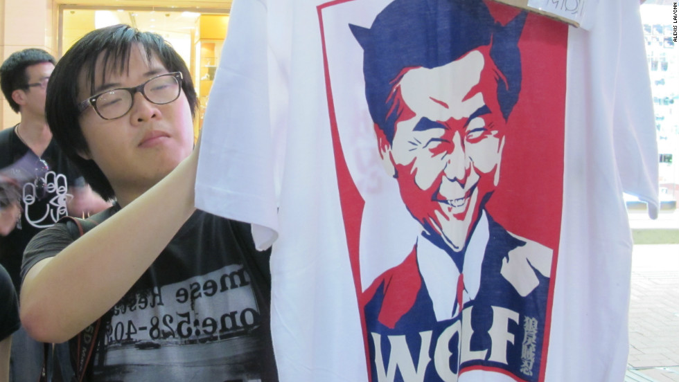 "Further down Great George Street, a 27-year-old man surnamed Chow sells  T-shirts depicting Hong Kong Chief Executive-elect Leung Chun-ying.  Although he was only four years old at the time of the crackdown, Chow says he chose to volunteer his services with his friends Monday to show his ""opposition toward the Chinese Communist Party and its disregard for the law."""