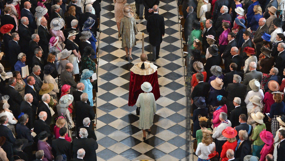 Queen Elizabeth II arrives inside St Paul's Cathedral for the service. She attended the service without her husband Prince Philip, who is in hospital with a bladder infection.