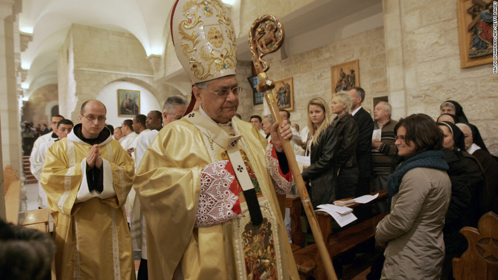 Latin Patriarch of Jerusalem Fouad Twal leading last year's Christmas midnight Mass at the church.