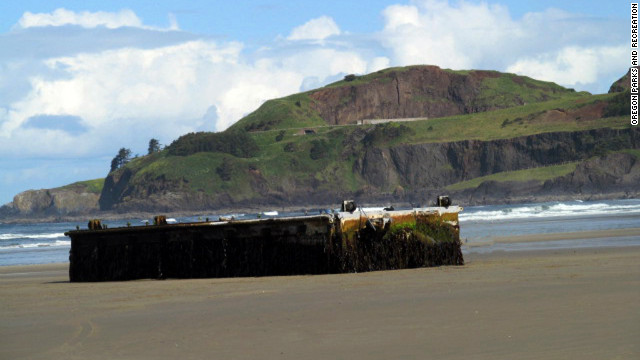 A dock has washed shore near Agate Beach after it was first sighted floating in the water on Monday.