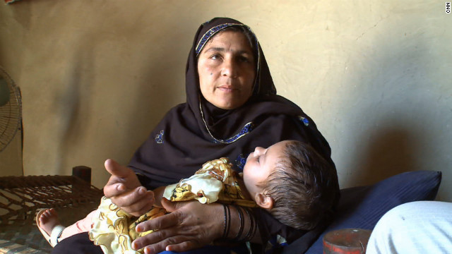 Polio-stricken 3-month-old Ikra and her mother in Nowshera, Pakistan, in July.