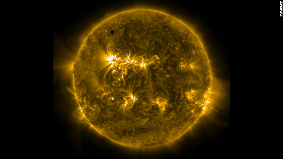 An ultraviolet image taken from NASA's Solar Dynamics Observatory spacecraft shows Venus at the top left of the sun.