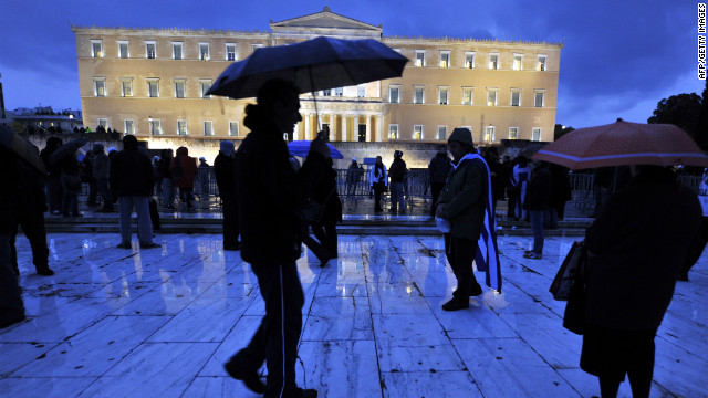 Protesters gather in the rain for a demonstration against austerity measures at the Greek parliament in Athens in February .