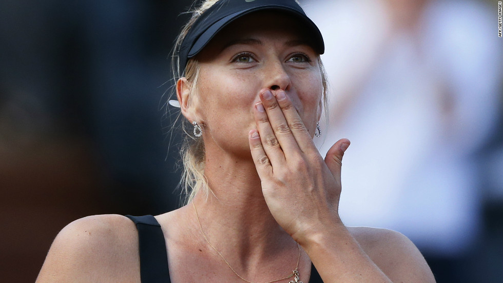 Russian tennis star Maria Sharapova blows a kiss to the crowd after beating Petra Kvitova at Roland Garros on Thursday to reach her first French Open final.