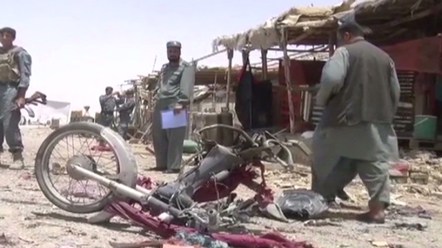 Suicide bombers kill dozens in Afghan