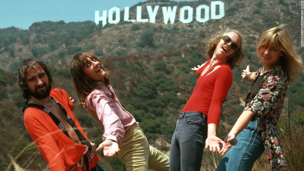 British-American band Fleetwood Mac formed in 1967. John McVie, Mick Fleetwood, Bob Welch and Christine McVie pose in front of the Hollywood sign circa 1970.