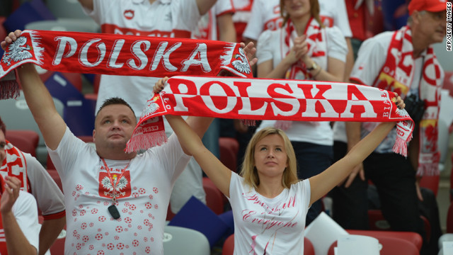 Polish fans cheer before the Euro 2012 football championships match Poland vs. Greece, on June 8, 2012 at the National Stadium in Warsaw.