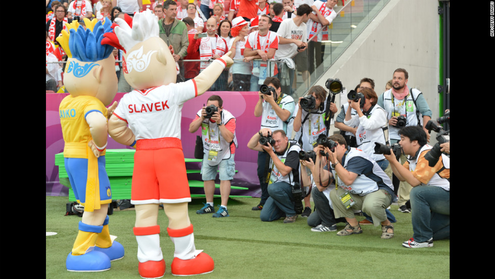 Mascots Slavko, left, and Slavek, right, pose before the match between Poland and Greece.