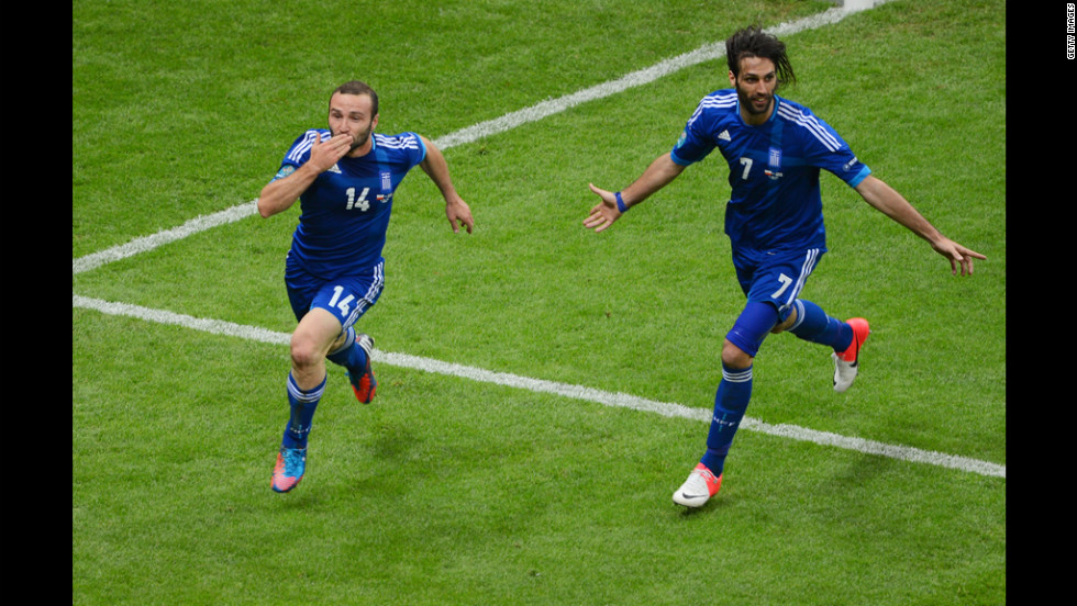 Dimitris Salpigidis and Georgios Samaras of Greece celebrate their first goal against Poland.