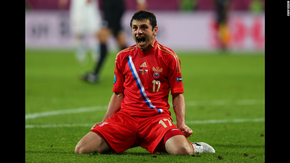 Alan Dzagoev of Russia celebrates scoring the team's third goal against Czech Republic.