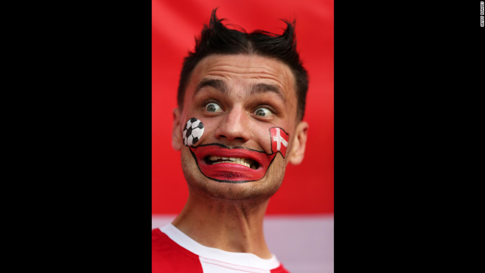 A Danish fan mugs before the match between the Netherlands and Denmark.