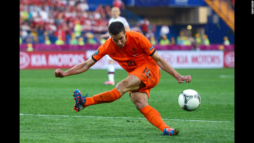 Robin van Persie of the Netherlands misses a chance at goal against Denmark.