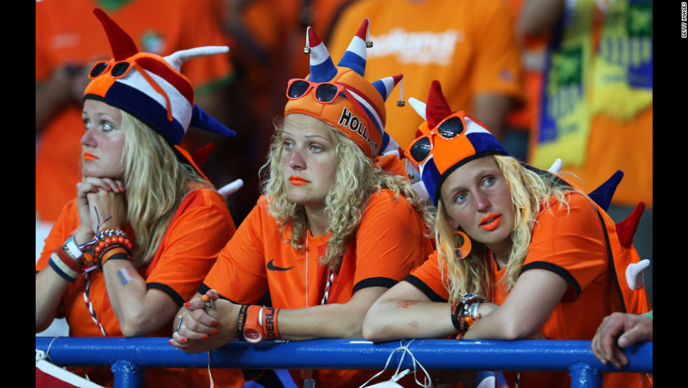 Dutch fans look dejected at the final whistle during the Netherlands-Denmark match.